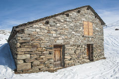 mountain hut in the snow Royalty Free Stock Photo