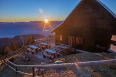 Mountain hut at sunset Stock Photos