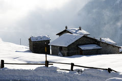 Mountain hut under snow Stock Photography