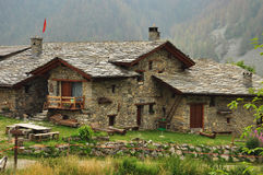 Mountain hut Viviere, Maira valley, Cuneo, Italy. Traditional alpine stone architecture. Mountain hut Viviere in the Maira Valley, province of Cuneo, Italian stock images