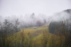 Mountain hut in wafts of mist Royalty Free Stock Photography
