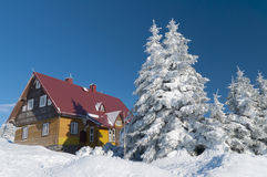 Mountain hut in winter. Sunny day stock photography