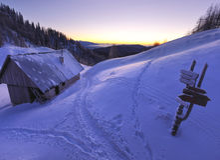 Mountain hut. In winter befotre sunrise.Slovenia, Blejska koca Royalty Free Stock Image