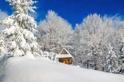 Mountain hut in winter landscape Royalty Free Stock Images