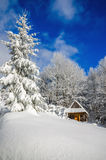 Mountain hut in winter landscape woods. Mountain hut in winter landscape in woods covered with snow stock photo