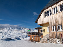 Mountain hut in winter time Stock Images