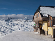 Mountain hut in winter time Royalty Free Stock Image