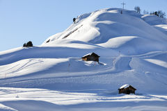 A mountain hut in winterly alpine scenery Royalty Free Stock Photo