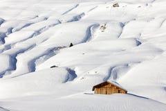 A mountain hut in winterly alpine scenery Stock Photo