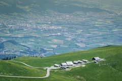 Mountain huts ot the green hill in front of rhineland valley Royalty Free Stock Photos