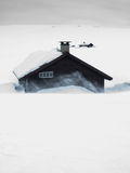 Mountain huts in snow storm Royalty Free Stock Images