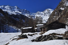 Mountain huts under snow, Italian Alps, Aosta Valley. Stock Photo