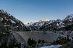 Mountain hydro dam in the morning. Royalty Free Stock Image