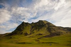 Mountain in Iceland. A beautiful mountain in Iceland, covered with grass stock photo