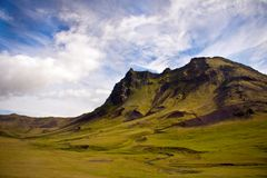 Mountain in Iceland. A beautiful mountain in Iceland, covered with grass Stock Image