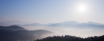 Mountain In Fog And Sunrise Royalty Free Stock Photos