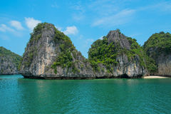 Mountain island and lonely beach in Halong Bay. Vietnam, Southeast Asia royalty free stock image