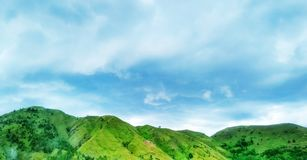 Mountain. Its a green mountain, and a blue sky Royalty Free Stock Image