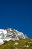 Mountain jet trail Royalty Free Stock Photos