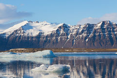 Mountain in Jokulsarlon lake with clear blue sky Royalty Free Stock Photos