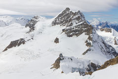 Mountain Jungfrau and mountain Stock Images