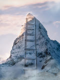 Mountain ladder. Is abstract photo of a ladder next to the mountain in the cold morning Royalty Free Stock Photo