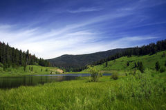 Mountain Lake. A beautiful mountain lake on a summer's day Royalty Free Stock Images