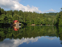 Mountain lake. Chalet situated on a shore of a mountain lake Stock Images