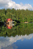 Mountain lake. Chalet situated on a shore of a mountain lake Royalty Free Stock Photography