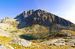 Mountain lake. With the high peaks in background stock images
