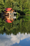 Mountain lake. Chalet situated on a shore of a mountain lake Stock Photos