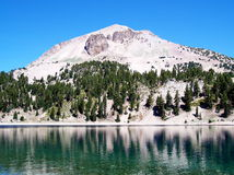 Mountain Lake. Lassen Peak towers over Lake Helen in Lassen Volcanic National Park Royalty Free Stock Photos