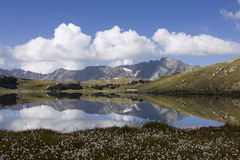 Mountain lake. With peak reflexion. Italian Alps, Cloudy sky Stock Photography