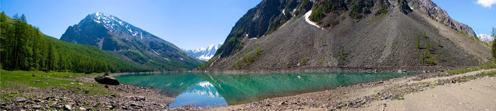 Mountain lake. In background with high mountain Stock Photo