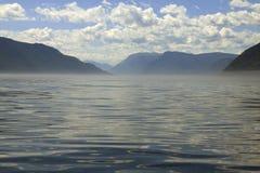 Mountain lake. Fog on big mountain lake stock image
