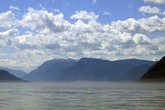 Mountain lake. Fog on big mountain lake royalty free stock photography
