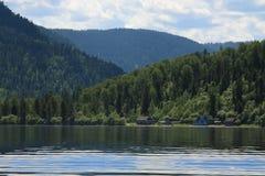 Mountain lake. Village on the bank of mountain lake royalty free stock photography