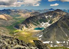 Mountain Lake. In the glacial moraine, bathed in sunlight. View of the mountain valley Royalty Free Stock Photo