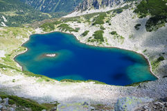 Mountain lake. With turquoise water shot from above Stock Images