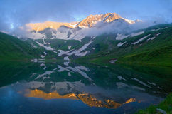 Mountain Lake. The sun's rays illuminate the mountains above Lake stock photo
