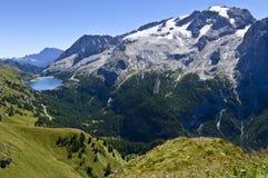 Mountain lake. And Marmolada glacier in the Dolomites, Italy royalty free stock photo