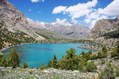 Mountain lake. In background with high mountain Stock Photos