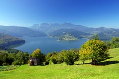 Mountain and lake. Fresh summer landscape with Carpathian mountain and lake, Romania Stock Images