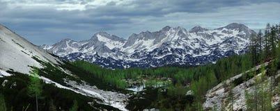 Mountain lake. And high snow mountains Stock Image