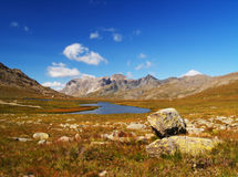 Mountain lake. A beautiful view of a mountain lake in a sunny day of summer Stock Photo