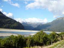 Mountain lake. A view across a New Zealand lake to a large mountain range in the distance Royalty Free Stock Photo