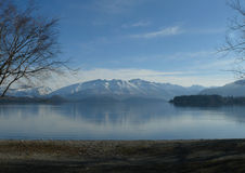 Mountain lake. Lake Wanaka on a calm day surrounded by snowy mountains Stock Photo