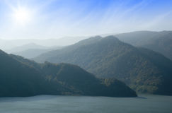 Mountain lake. Beautiful view of a mountain lake, in a sunny autumn day in Romania Stock Image