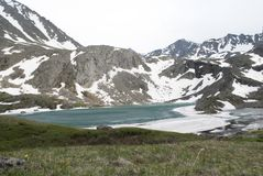 Mountain lake Akchan, Altai Republic. Turquoise mountain lake, lake in the mountains, green water, pure mountain lake, snow-capped mountains Royalty Free Stock Photography
