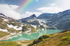 Rainbow over mountain lake in alps, Austria Royalty Free Stock Photo